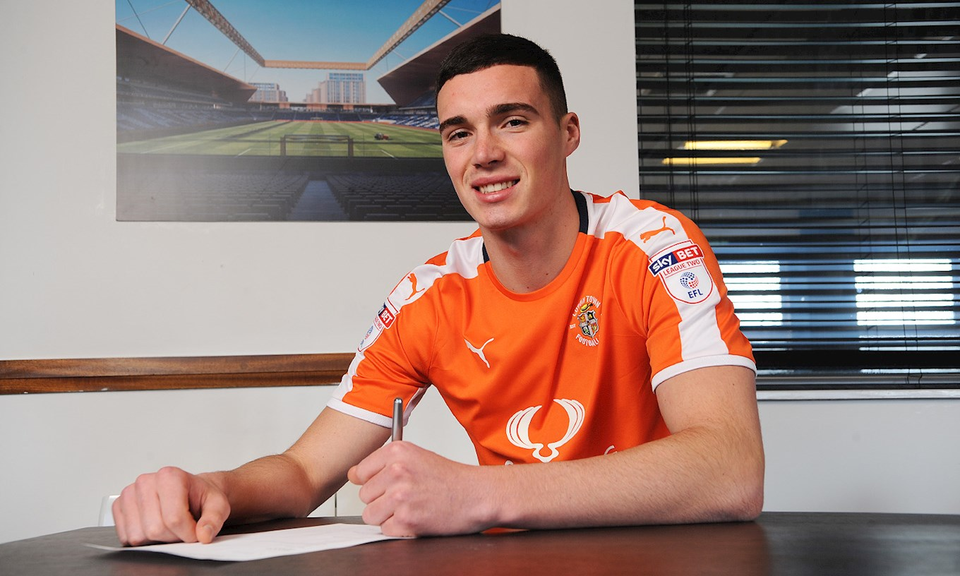 Lloyd Jones signs his two-and-a-half year contract with Luton Town after moving from Liverpool for an undisclosed fee