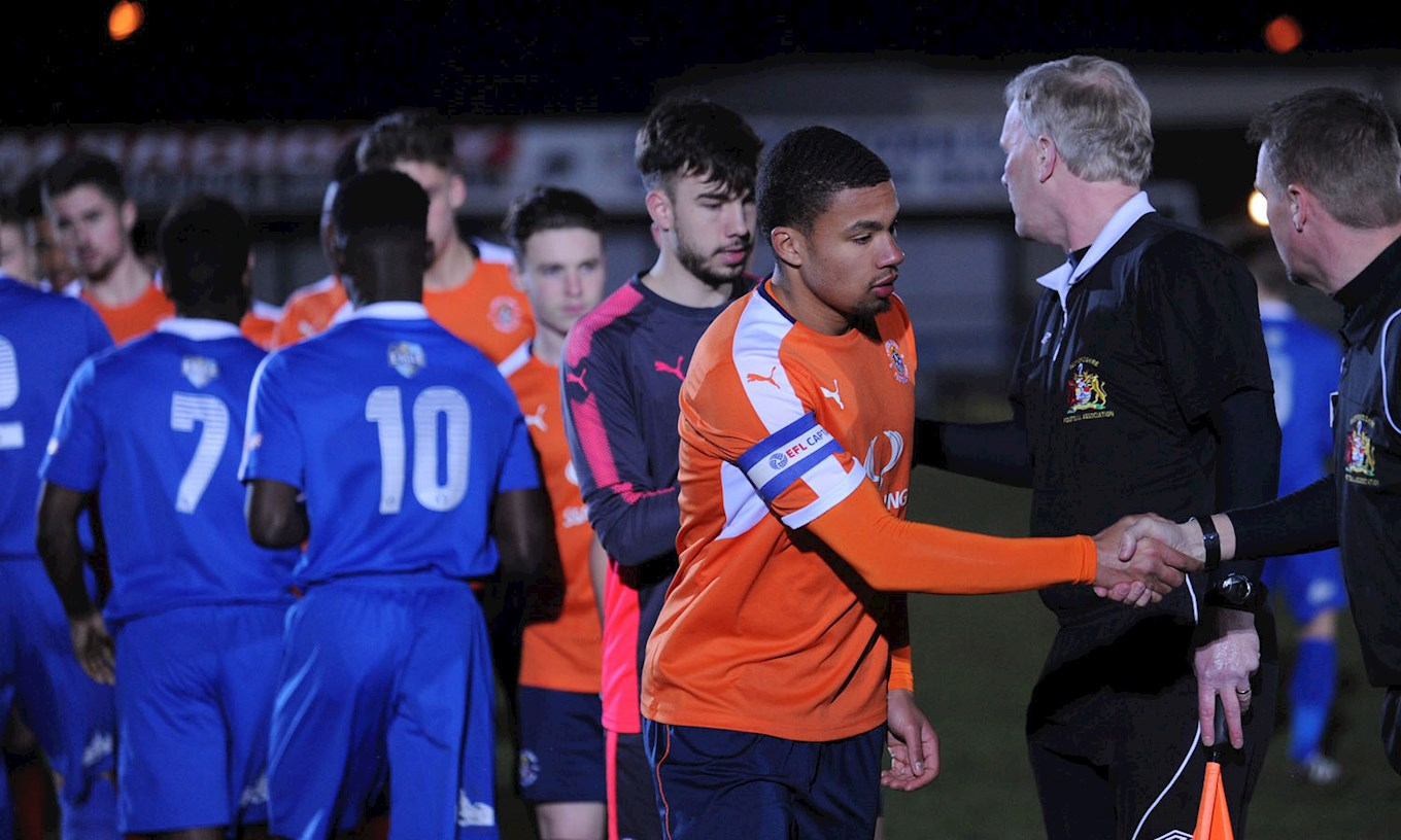 Captain Frankie Musonda is pictured shaking hands with the Bedford players before the Beds FA Senior Cup semi-final, a match in which he went on to net the late winner