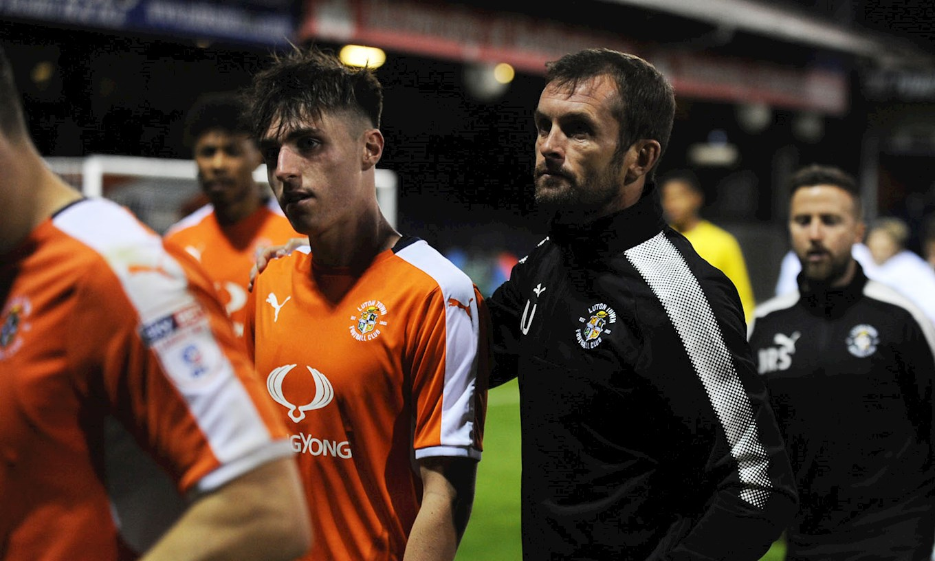 Jack James walks off the Kenilworth Road pitch with manager Nathan Jones at the end of his impressive senior debut against Tottenham Under-21s last August