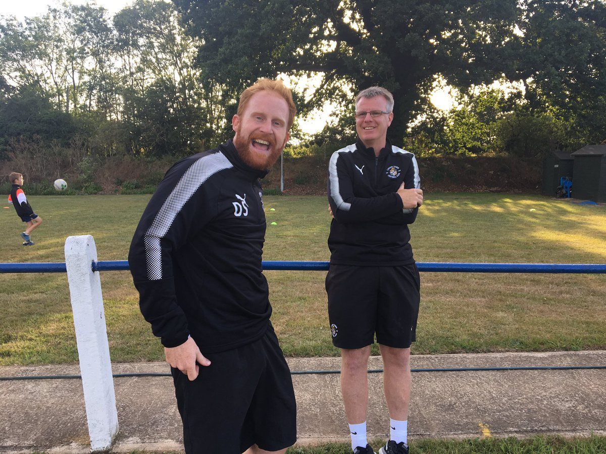 Academy manager Andy Awford, right, is all smiles with physio Dan Simm on his 45th birthday