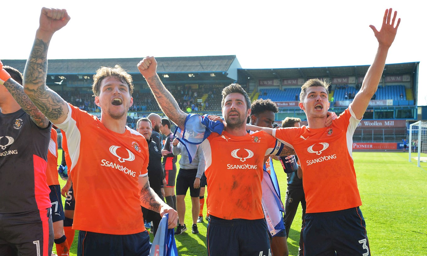 Glen Rea leads the League Two promotion celebrations at Carlisle in April 2018 with Alan Sheehan and Dan Potts