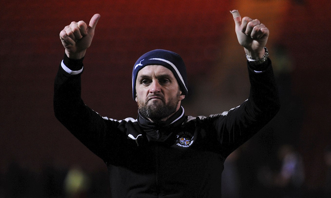 Hatters boss Nathan Jones salutes the crowd after the win at Crewe on November 25th