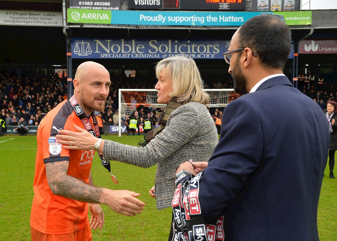 Alan McCormack receives his runners-up medal at the end of Saturday's win over Forest Green