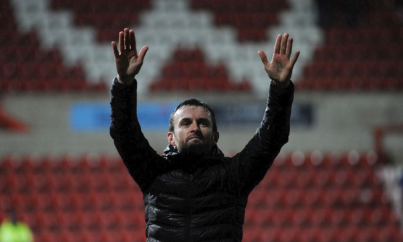 Manager Nathan Jones salutes the travelling fans at the end of the 5-0 Boxing Day win at Swindon