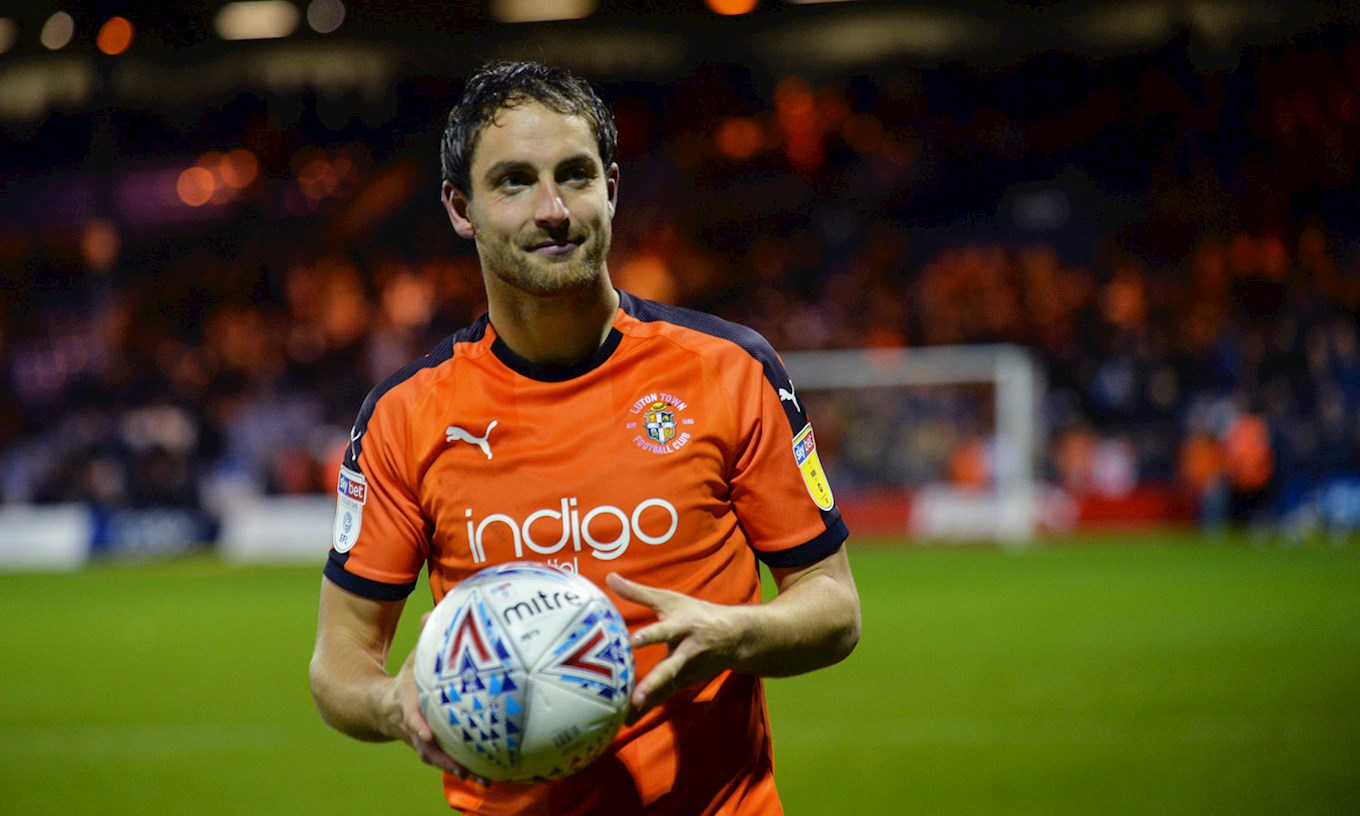 Danny Hylton takes the matchball home after netting a hat-trick in the 4-1 win over Accrington