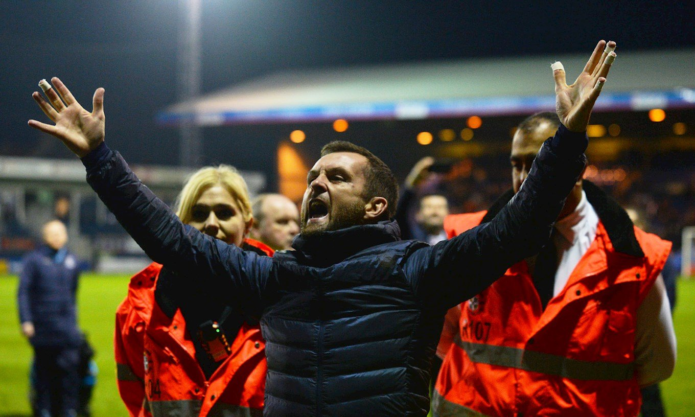Nathan celebrates in front of the Town fans after the 5-1 win over Plymouth at Kenilworth Road