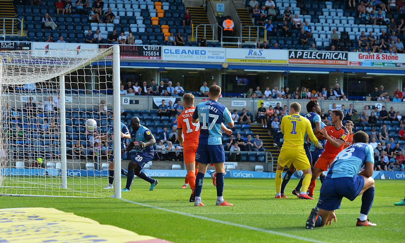 Matty Pearson heads in the equaliser at Wycombe