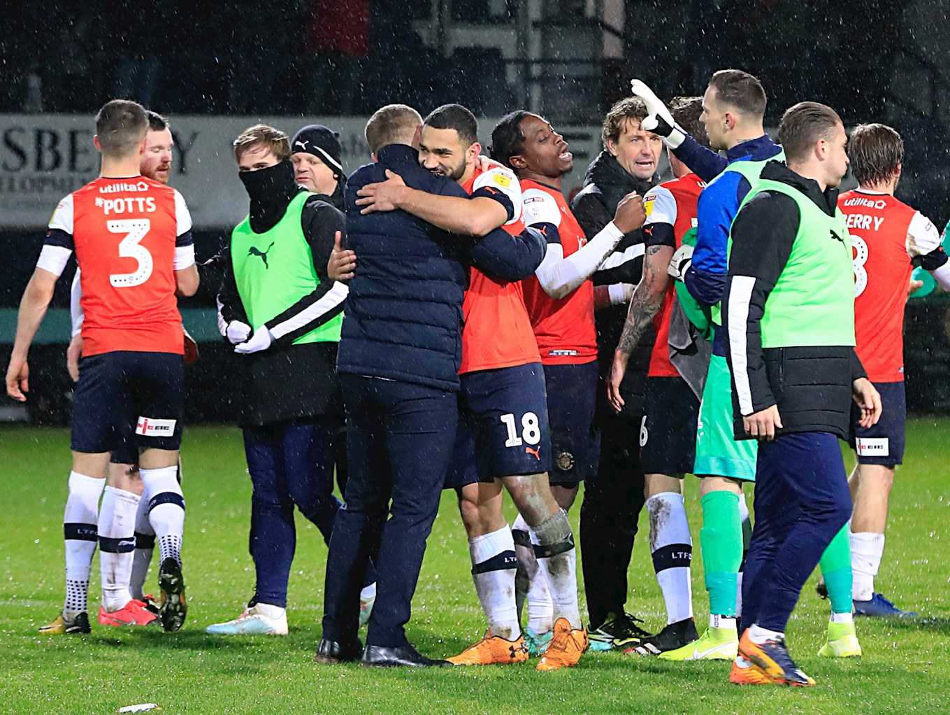 Graeme Jones and the players and staff congratulate each other on beating Brentford at Kenilworth Road