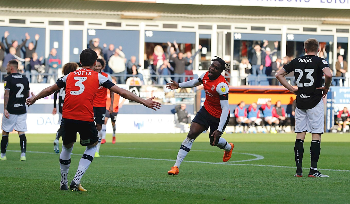 Pelly-Ruddock Mpanzu wheels away in delight after putting the Hatters in front against Bristol City