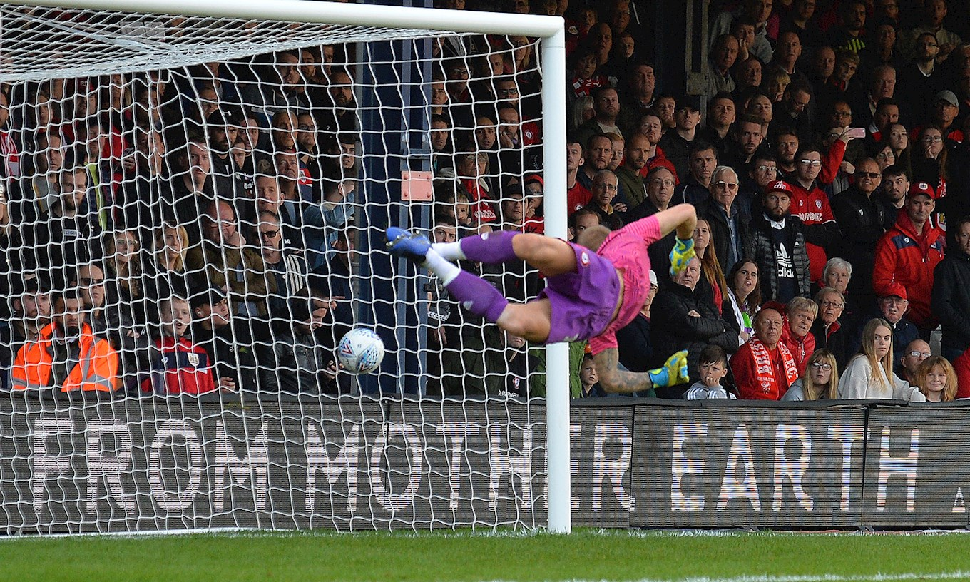 Pelly-Ruddock Mpanzu curls his 15th Luton Town goal past the despairing dive of Bristol City goalkeeper Daniel Bentley