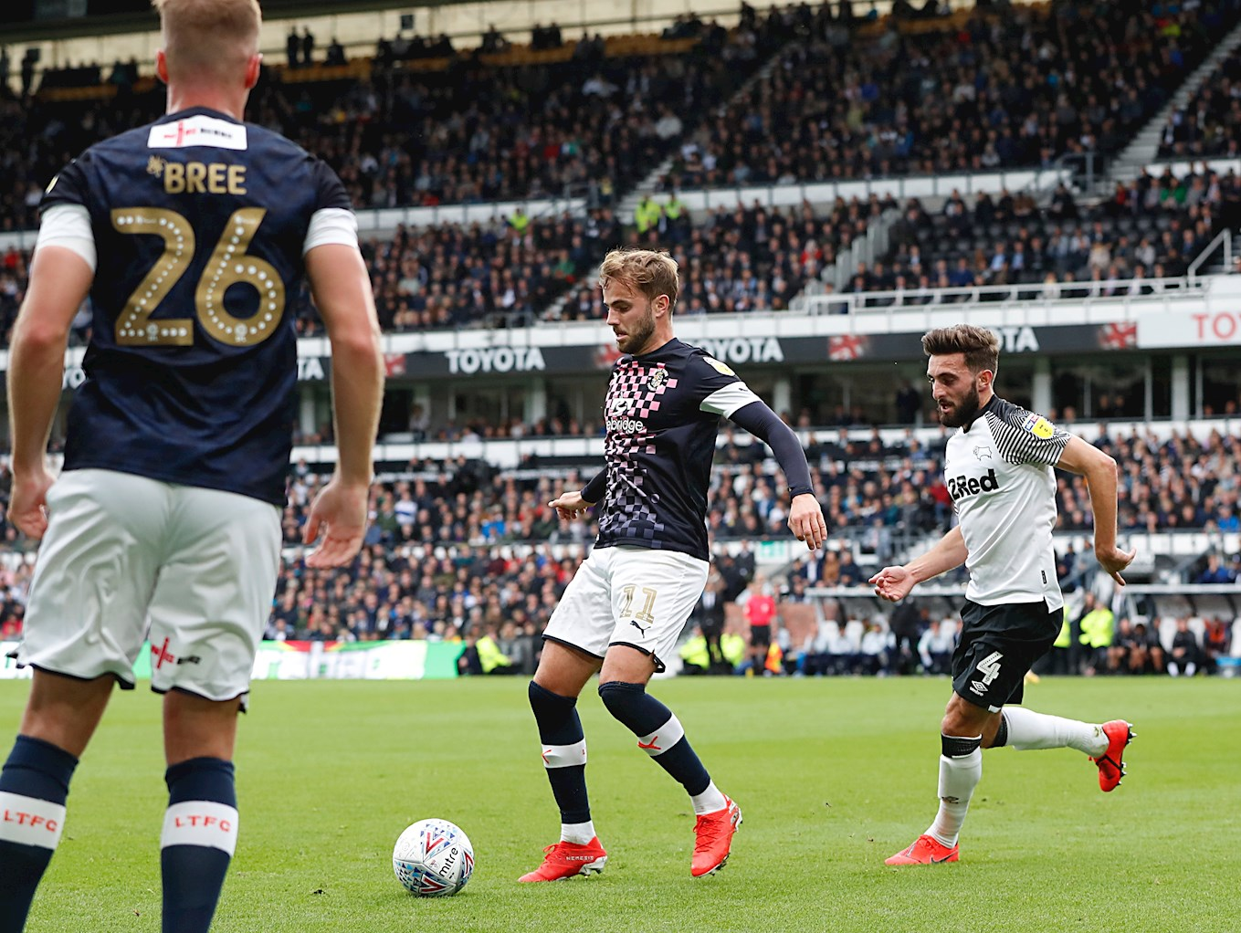 Hatters playmaker Andrew Shinnie shields the ball from his brother Graeme, the Derby County midfielder, in the game at Pride Park