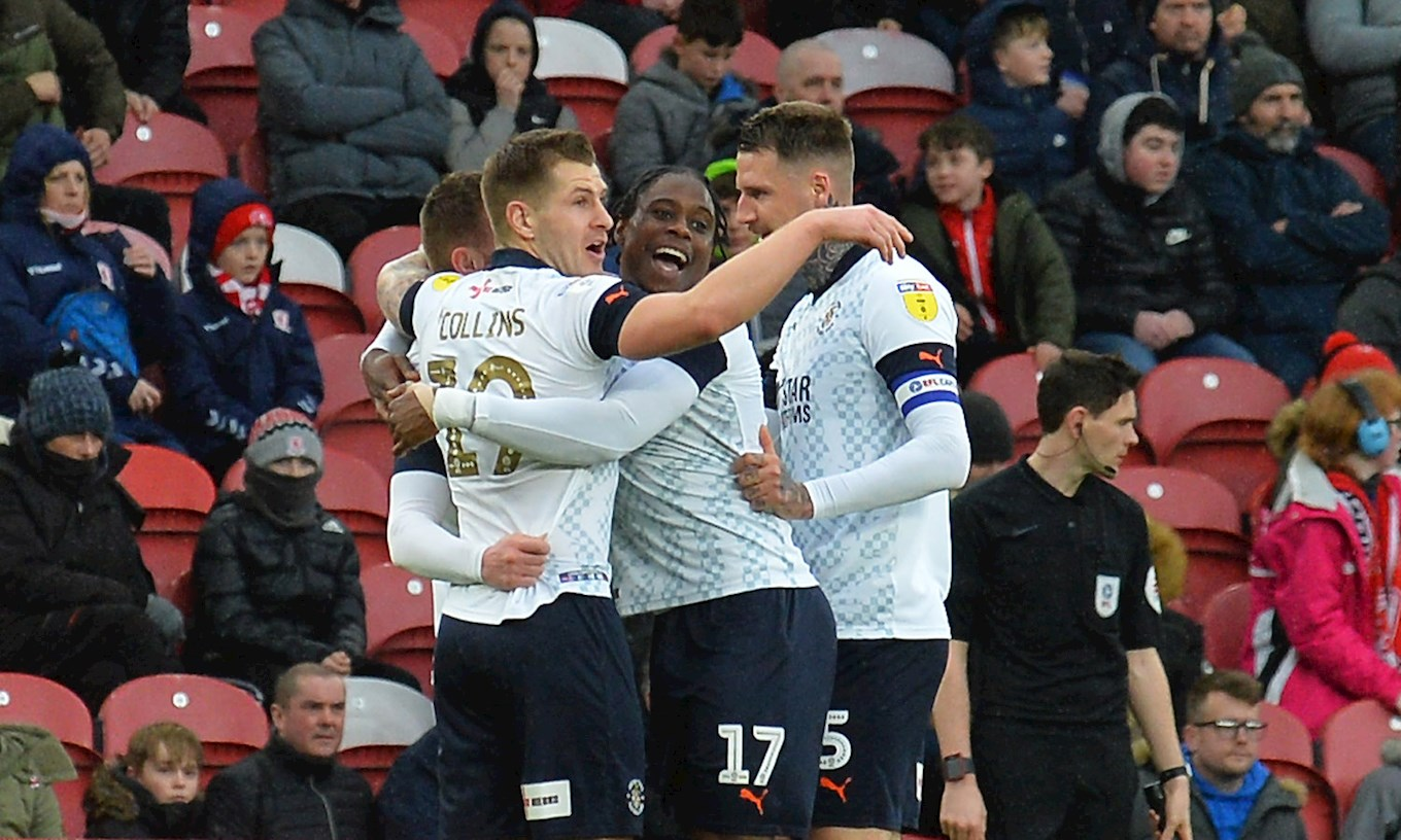 Ryan Tunnicliffe is mobbed by his team-mates after netting the Town's winner at Middlesbrough