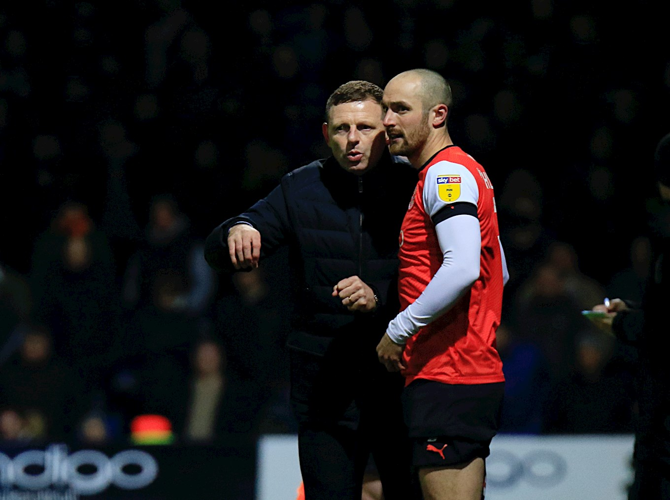 Danny Hylton gets instructions from manager Graeme Jones during his Championship debut against Sheffield Wednesday
