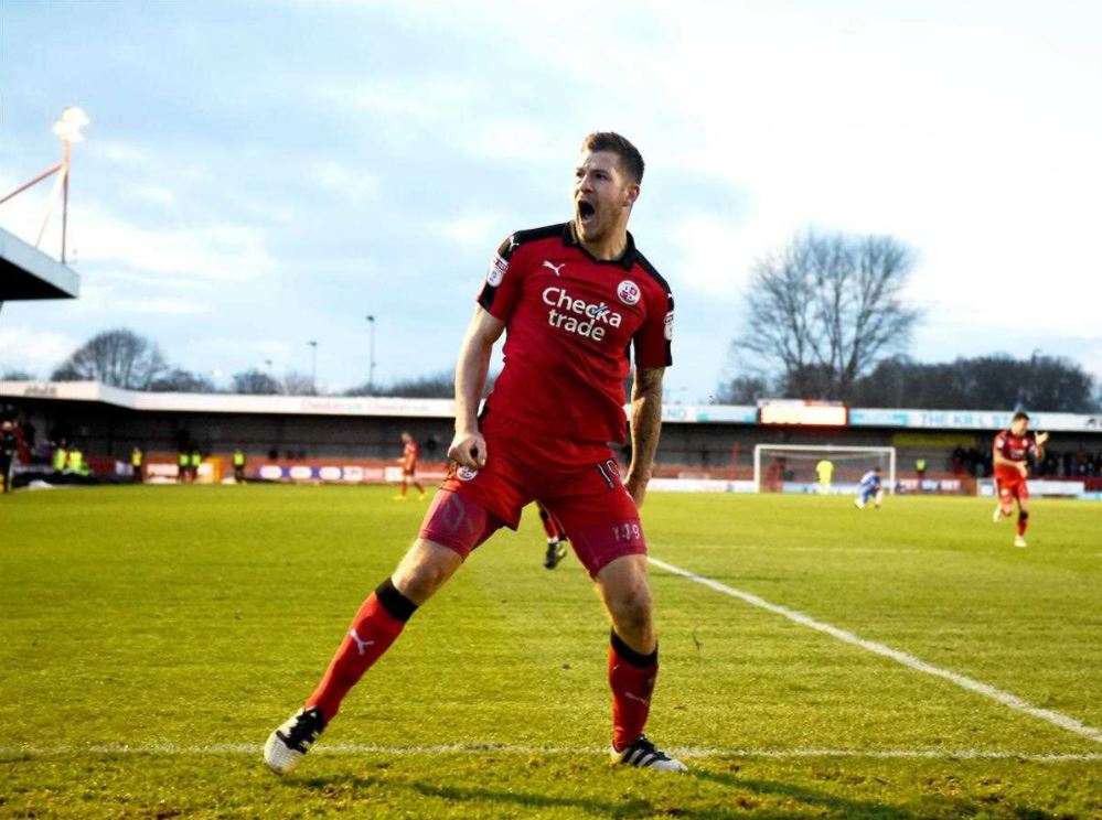 James Collins celebrating a goal for Crawley, from whom the Hatters signed him in 2017