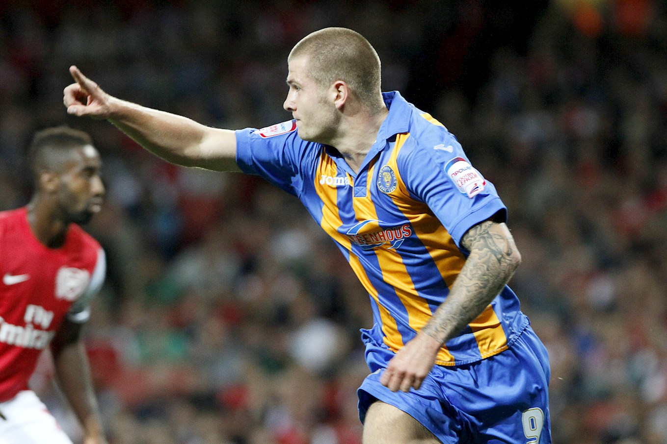 James Collins celebrating a goal for Shrewsbury Town against Arsenal early in his career