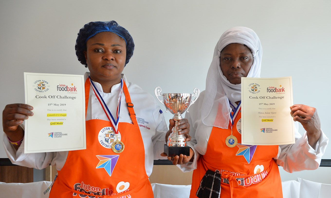 Hawa Adam Tijani and Loveth O I Osagie receive their awards for finishing as Gold Medallists