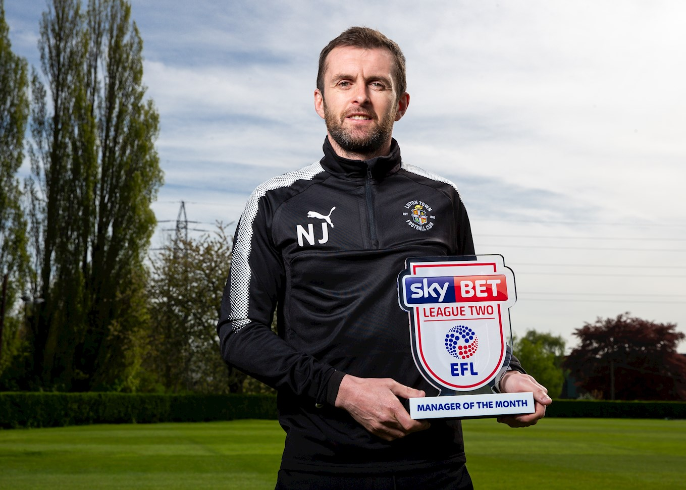 Hatters boss Nathan Jones with his Sky Bet League Two manager of the month award for April - the third one he has won during 2017-18