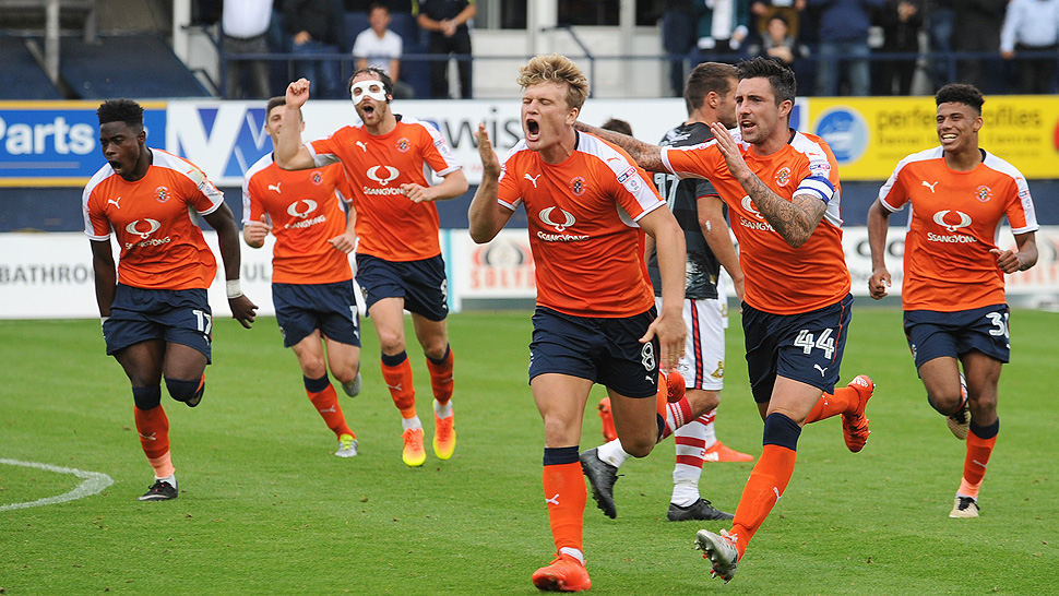 Cameron McGeehan celebrates another goal for the Hatters