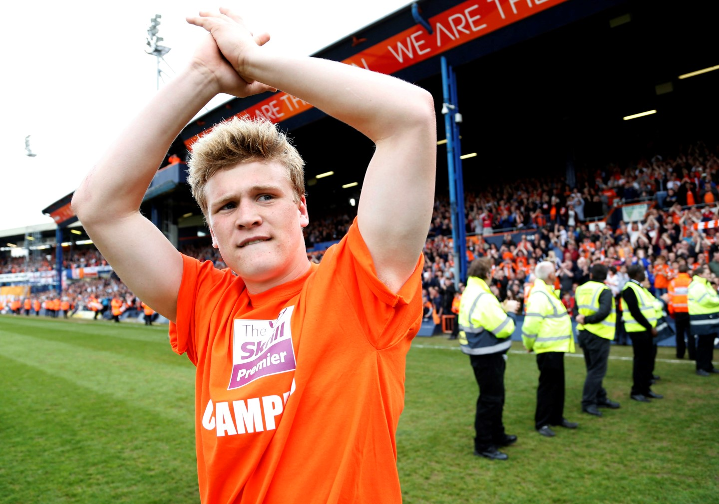 Cameron McGeehan walks out to collect his Conference title winner's medal at Kenilworth Road in 2014