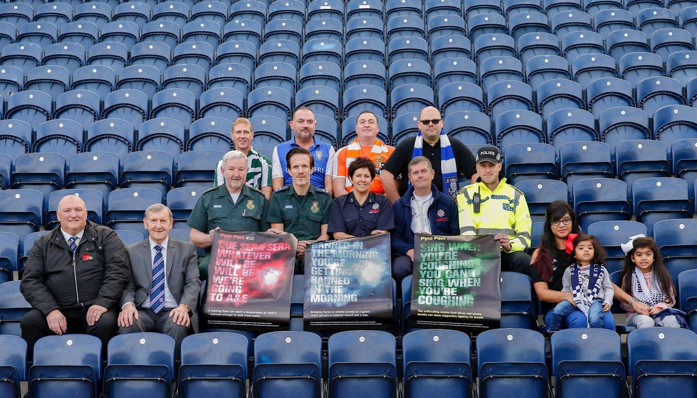 From right to left:  Front row: Nisha, Khaya and Maya (fans), David Dent (President of Carlisle United), Mark Farnworth (Preston North End Ground Safety Officer) Middle row: Nick Mattock (Lancashire Constabulary), Pete Sutcliffe (North-West Ambulance Service), Jenny Nangle (Fire Safety Inspector, Lancashire Fire and Rescue Service), Tony Crook (Group Manager, Lancashire Fire and Rescue), Mick Doolan (North-West Ambulance Service) Top row: Paul Osbourne (fan), Roger Leigh (fan), Martin Coulson (fan) and Richard Lower (fan).