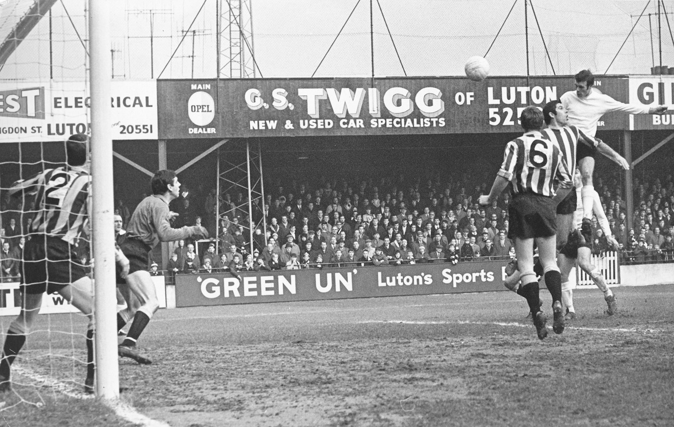 Matt Tees showing his prodigious leap during a 5-0 win at Kenilworth Road against Bradford City in 1969