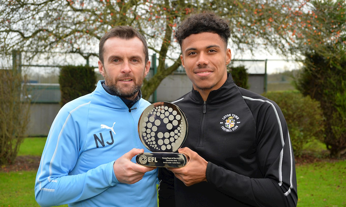 Hatters boss Nathan Jones presents James Justin with his EFL Young Player of the Month for November