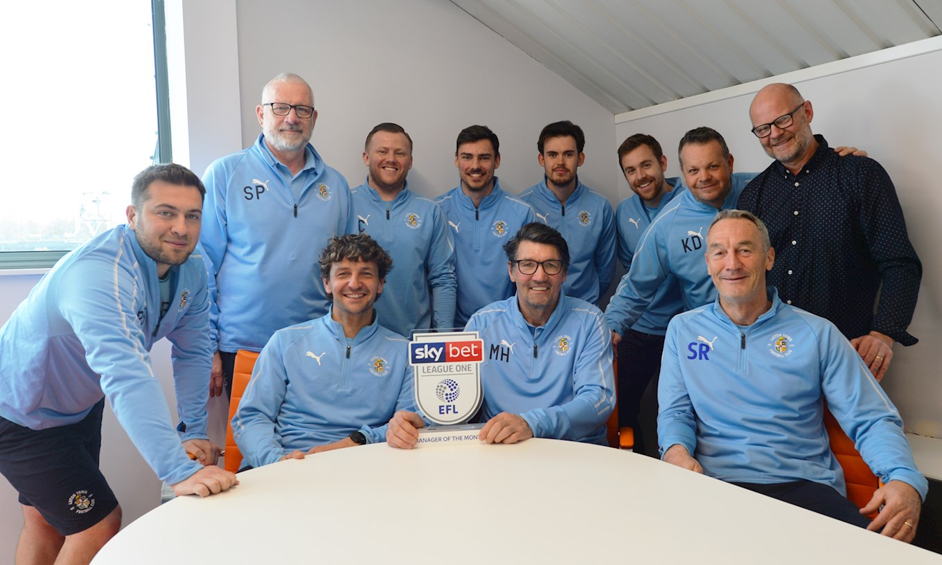 Mick Harford shares the Sky Bet League One manager of the month award for March with his staff at The Brache