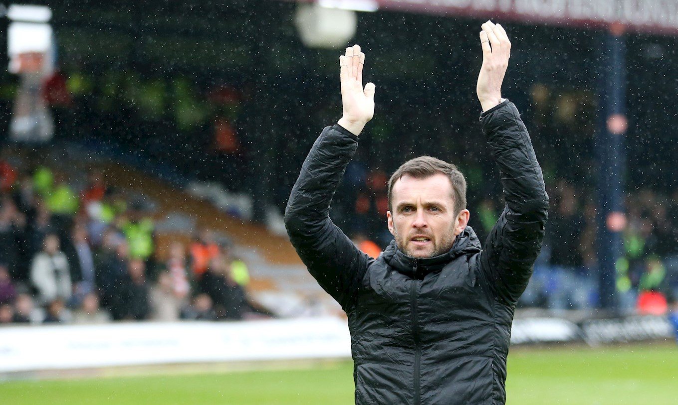Hatters boss Nathan Jones applauds the supporters after the final home game of the 2017-18 League Two promotion-winning season