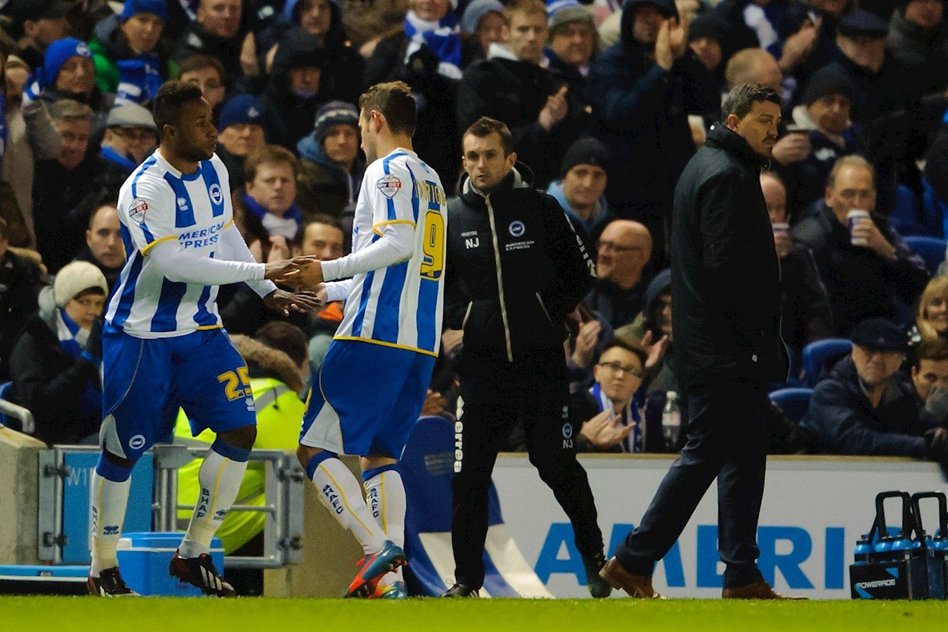 Kazenga LuaLua comes on as a substitute for Brighton, watched by then-Seagulls assistant-manager Nathan Jones