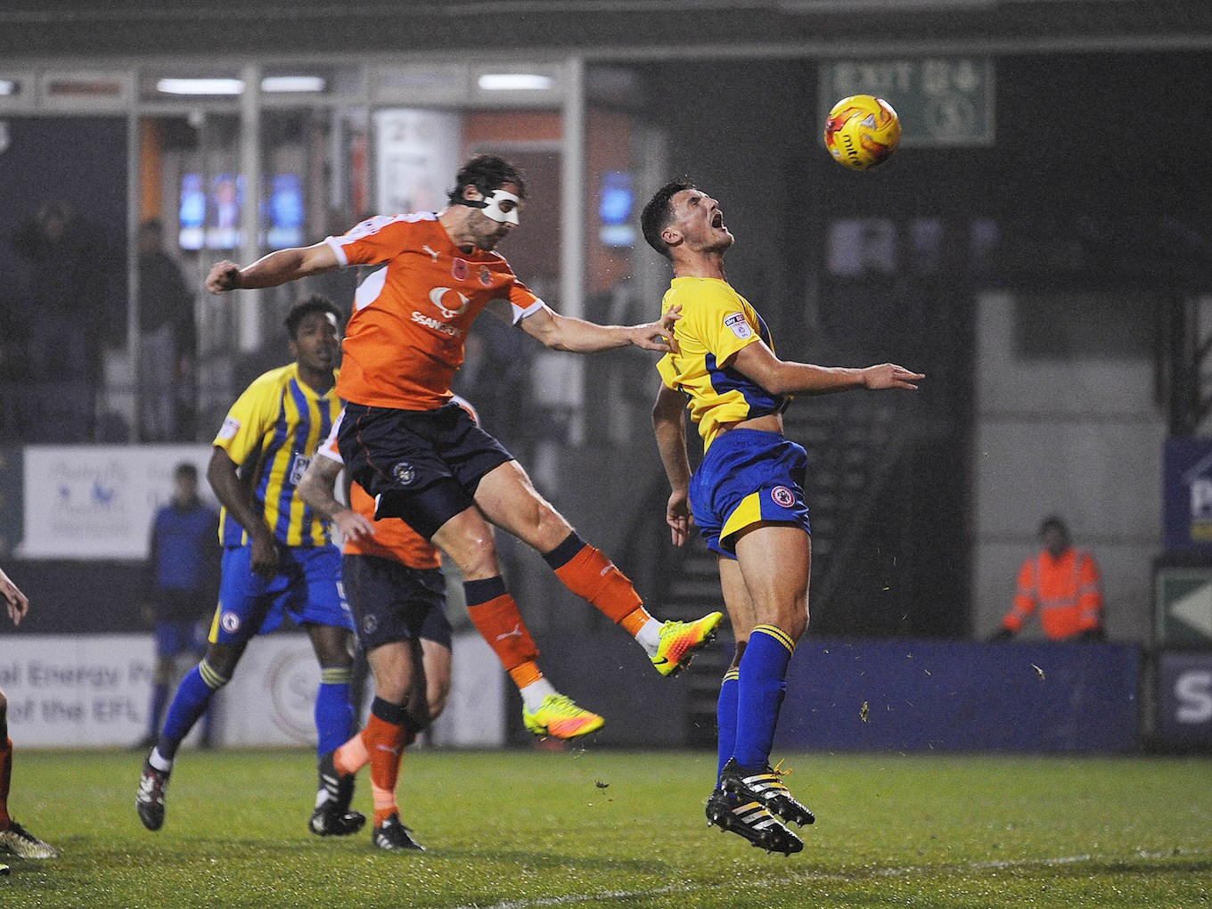 Matty Pearson comes up against Danny Hylton during the Hatters' November 2016 clash with Accrington at Kenilworth Road
