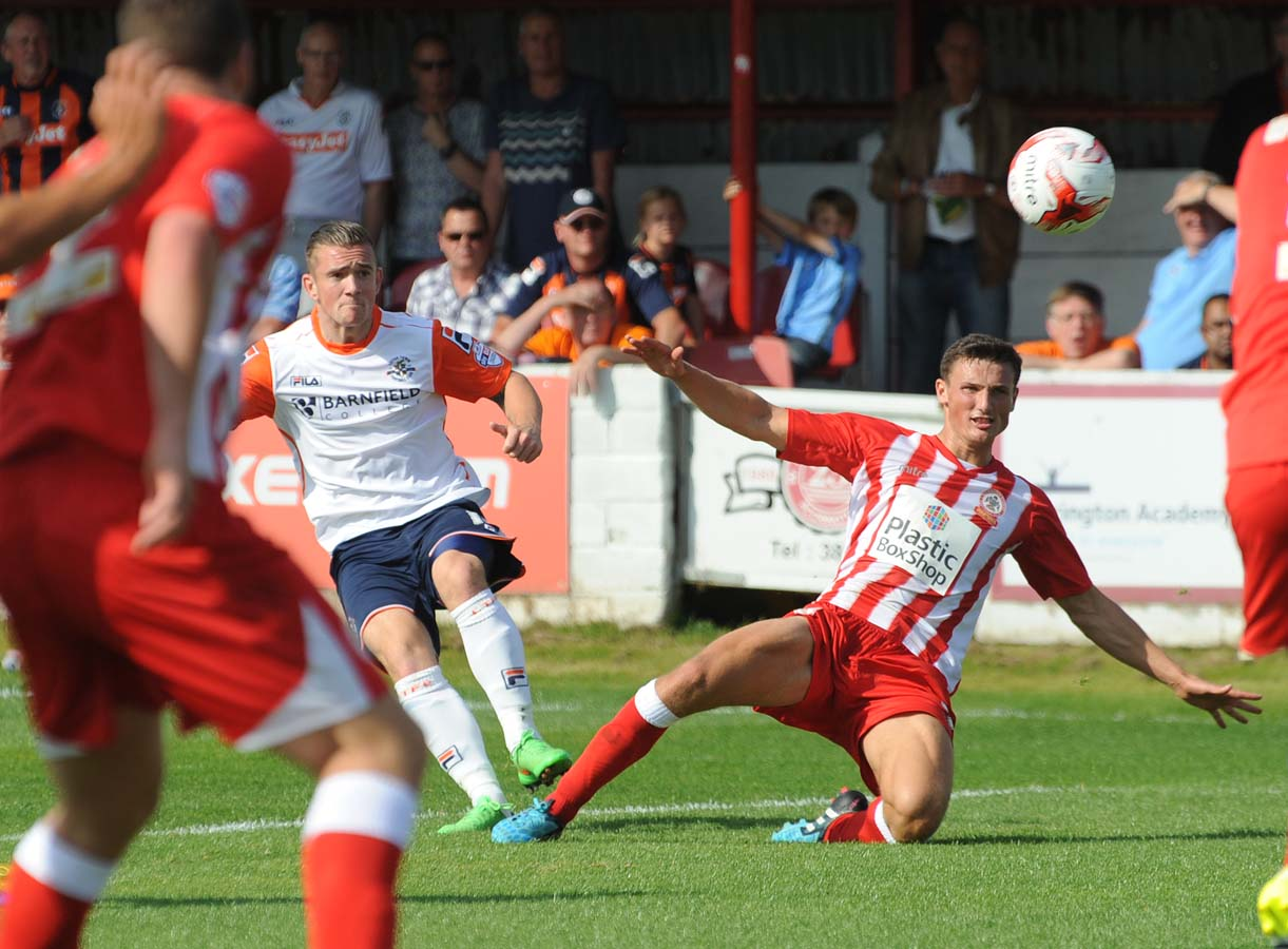 Matty Pearson attempts to block a shot from Jack Marriott when making his Accrington debut against the Hatters on the opening day of the 2015-16 season