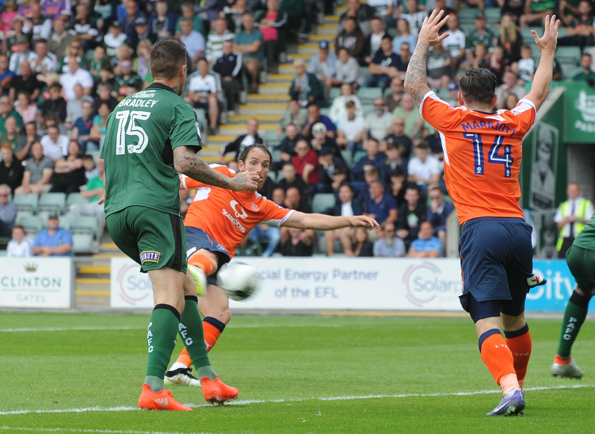 Then Plymouth defender Sonny Bradley can only look on as his former Aldershot team-mate Danny Hylton fires the Hatters in front on the opening day of the 2016-17 season