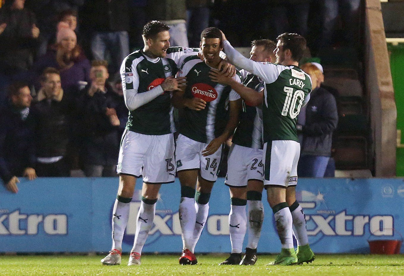 Sonny Bradley, far left, helps Jake Jervis celebrate a goal during their time together at Plymouth