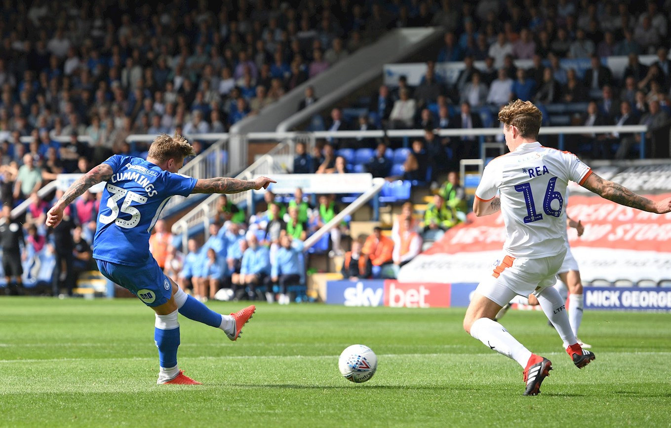 Jason Cummings fires in one of his two goals against the Hatters for Peterborough earlier this season