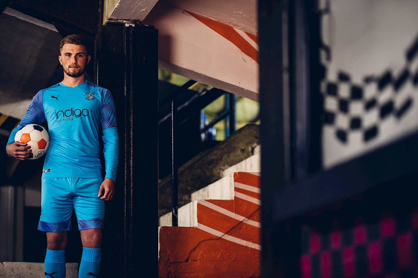 Harry Isted models the 2019-20 goalkeeper kit at Kenilworth Road