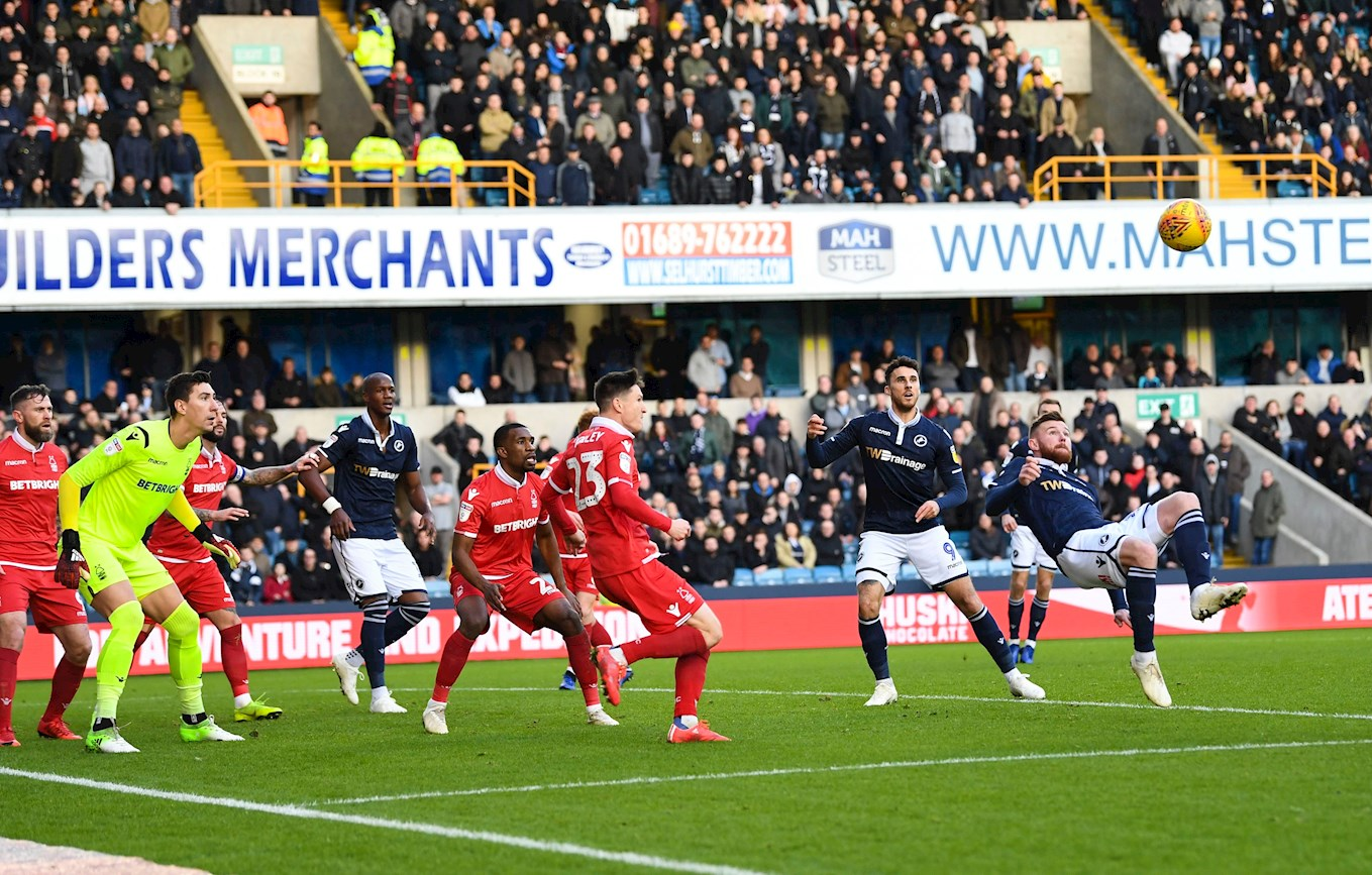Tunnicliffe (right) scores with an overhead kick for Millwall against Nottingham Forest last season